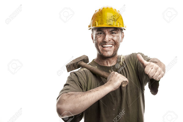 29565728 young dirty smiling worker man with hard hat helmet holding a  stock photo