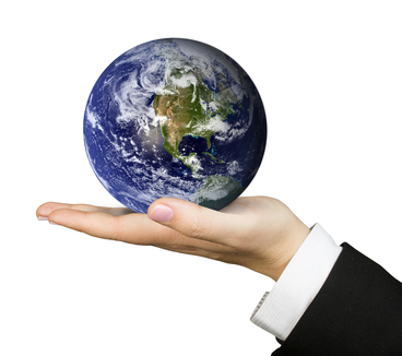 Stockfresh 284650 business hand holding earth sizexs